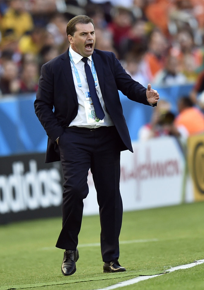 Photo - Australia's head coach Ange Postecoglou urges his team forward during the group B World Cup soccer match between Australia and the Netherlands at the Estadio Beira-Rio in Porto Alegre, Brazil, Wednesday, June 18, 2014.  (AP Photo/Martin Meissner)