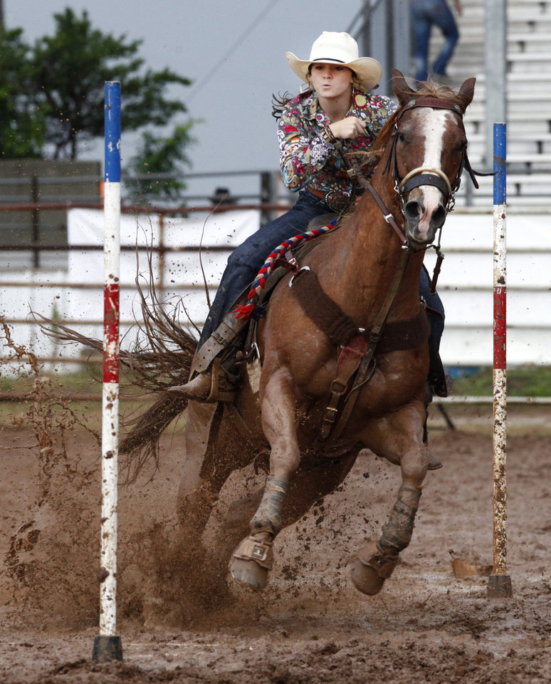 Photo - Chloe Frey, Eunice, LA, compete in a muddyPole Bending at the International Youth Finals Rodeo in Shawnee at the Heart of Oklahoma Exposition Center, Wednesday, July 9, 2014. Photo by David McDaniel, The Oklahoman