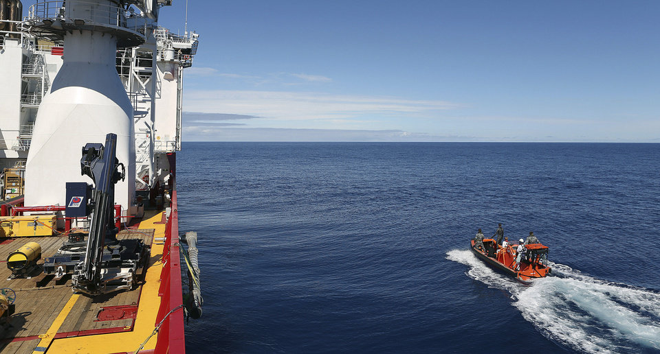 Photo - In this April 7, 2014 photo provided by the Australian Defense Force a fast response craft manned by members ofthe Australian Defense's ship Ocean Shield is deployed to scan the water for debris of the missing Malaysia Airlines Flight 370 in the southern Indian Ocean. Up to 14 planes and as many ships were focusing on a single search area covering 77, 580 square kilometers (29,954 square miles) of ocean, 2,270 kilometers (1,400 miles) northwest of the Australian west coast city of Perth, Australia. (AP Photo/Australian Defense Force, LSIS Bradley Darvill) EDITORIAL USE ONLY