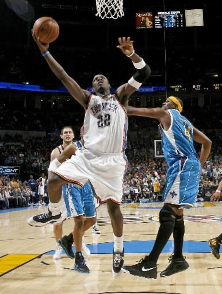 Oklahoma City's  Jeff  Green goes past James Posey of Hornets during the NBA basketball game between the New Orleans Hornets and the Oklahoma City Thunder at the Ford Center,Tuesday, Feb. 17, 2009. PHOTO BY BRYAN TERRY