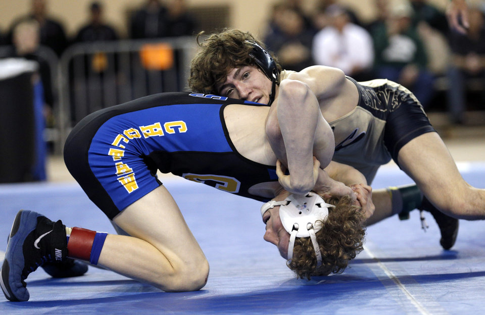 Photo - Sand Springs' Daton Fix, right, wrestles Choctaw's Garrett Rowe in the 6A 113-pound match during the Oklahoma State wrestling championships at the State Fair Arena, Saturday, March 1. 2014. Photo by Sarah Phipps, The Oklahoman