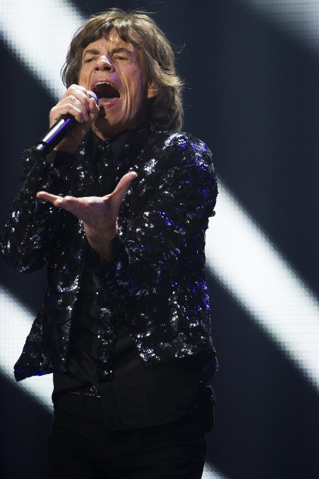 Photo - Mick Jagger of The Rolling Stones performs in concert on Saturday, Dec. 8, 2012 in New York. (Photo by Charles Sykes/Invision/AP)