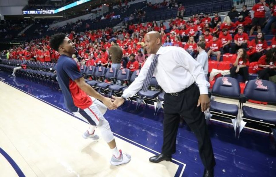 Photo -  Ole Miss assistant coach Win Case greets a player before the Rebels' Jan. 19 game against Arkansas. Case has many ties to Oklahoma, including as a player at OSU. [Josh McCoy/Ole Miss Athletics]