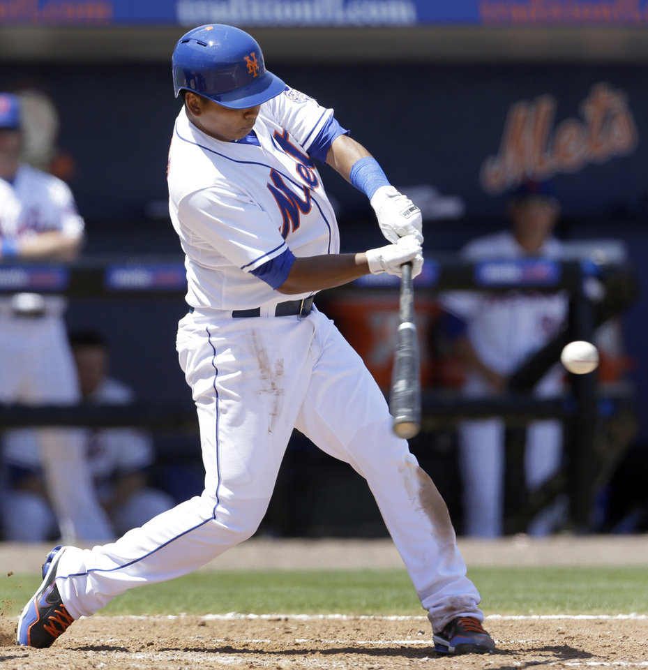Photo - New York Mets' Ruben Tejada hits a two-run double during the fourth inning of an exhibition spring training baseball game against the St. Louis Cardinals, Friday, March 29, 2013, in Port St. Lucie, Fla. (AP Photo/Jeff Roberson)