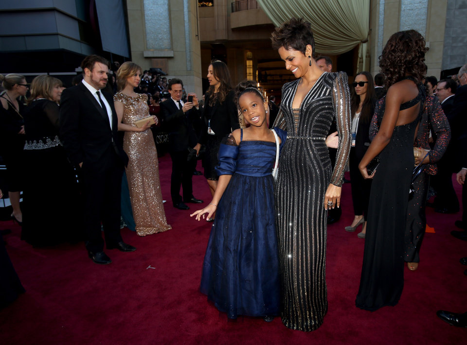 Actresses Quvenzhane Wallis, left, and Halle Berry arrive at the 85th Academy Awards at the Dolby Theatre on Sunday Feb. 24, 2013, in Los Angeles. (Photo by Carlo Allegri/Invision/AP)