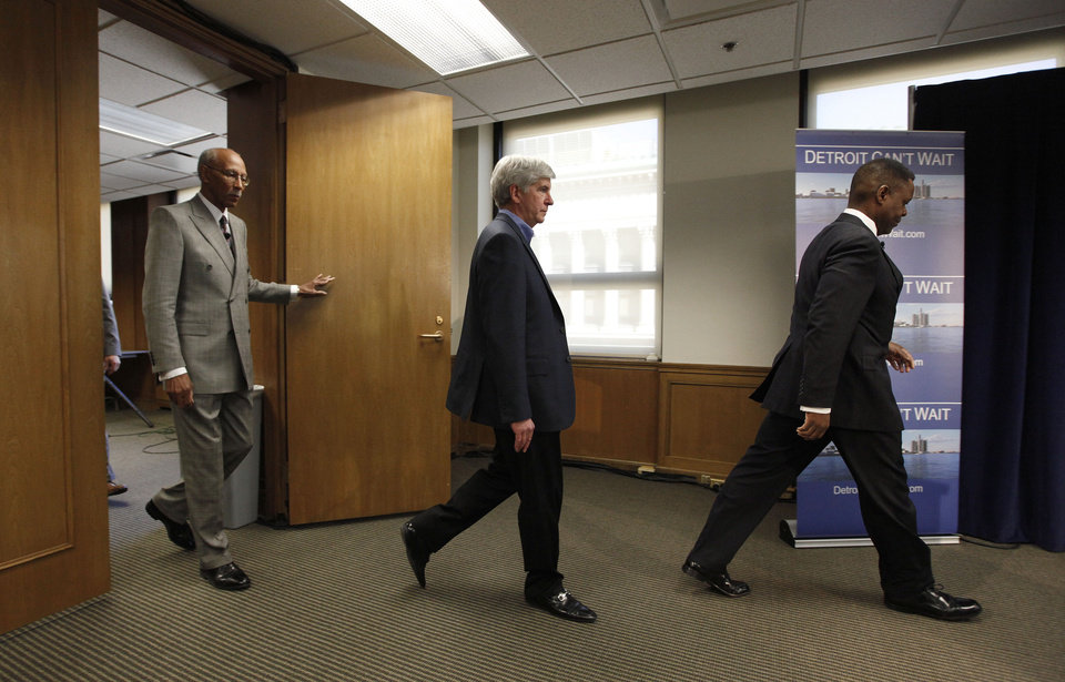 Photo - Detroit Mayor Dave Bing, from left, Gov. Rick Snyder and Kevyn Orr,  arrive at a news conference in Detroit, Thursday, March 14, 2013. Snyder announced that he had chosen Orr, a partner in the Cleveland-based law and restructuring Jones Day firm, as Detroit's emergency manager. Snyder's already declared a financial emergency in Detroit, saying local officials lacked a plan to solve it. (AP Photo/Paul Sancya)