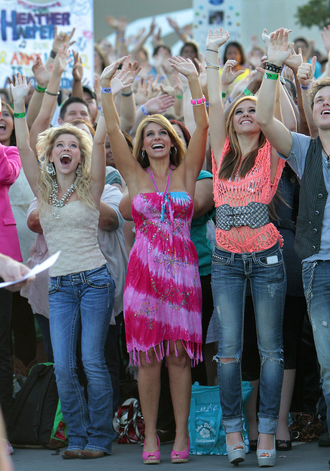 Contestants wave to the cameras before their American Idol auditions at the Peake, Friday, July 20 , 2012. Photo By David McDaniel/The Oklahoman