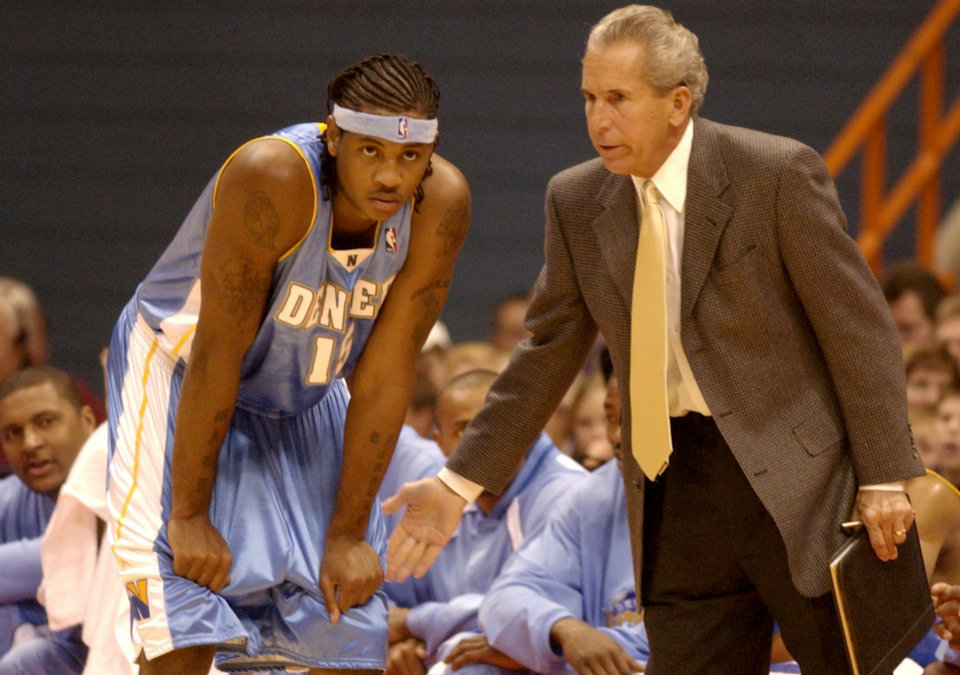 ** FILE **      NBA BASKETBALL: Denver Nuggets' Carmelo Anthony listens to assistant coach John MacLeod during a preseason game against the Detroit Pistons in Syracuse, N.Y., Sunday, Oct. 19, 2003. The last time Anthony and Syracuse head coach Jim Boheim were on the floor at Syracuse, they hoisted a national championship banner to the roof. On Sunday, Boheim settled into a courtside seat across from his familiar spot on the bench as the NBA Rookie Carmelo Anthony and the Nuggets played an NBA exhibition against the Pistons. (AP Photo/Kevin Rivoli)