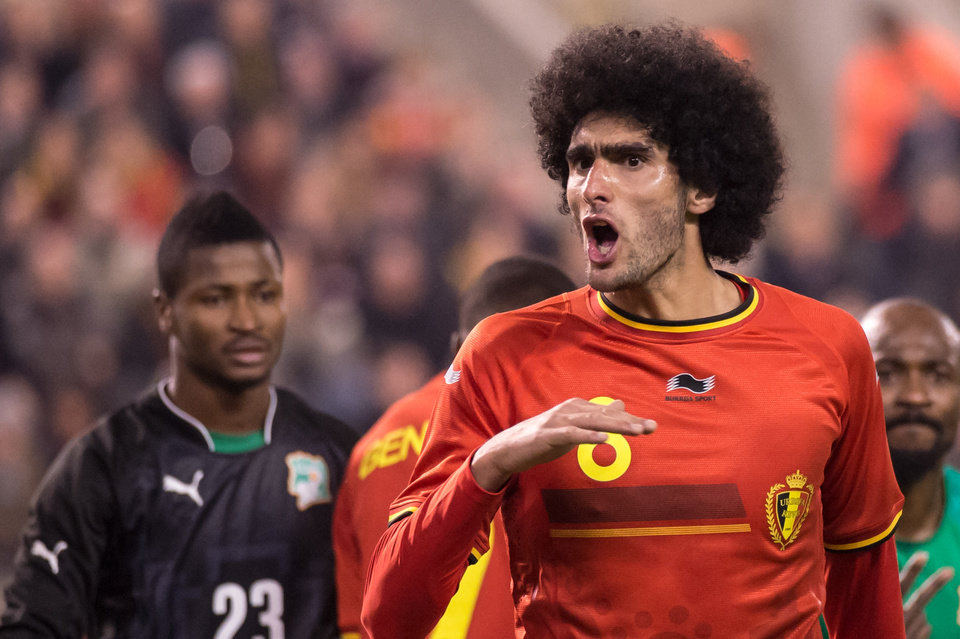 Photo - Belgium's Marouane Fellaini reacts during a friendly soccer match against Ivory Coast at the King Baudouin stadium in Brussels on Wednesday March 5, 2014. (AP Photo/Geert Vanden Wijngaert)