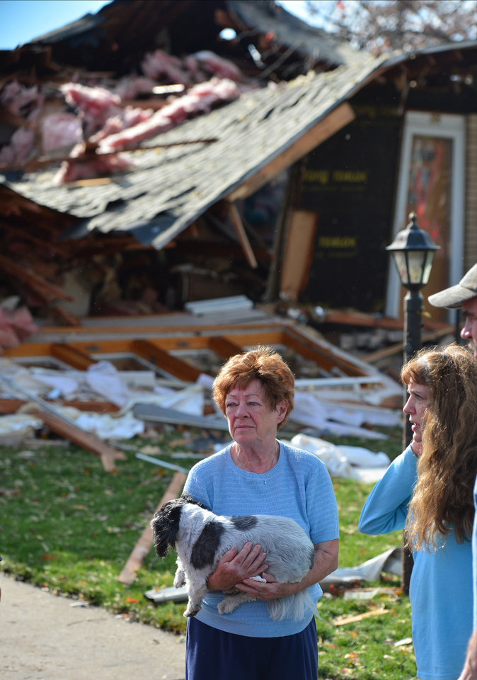 Photo - Shirley Wolf says she hung on to her dog Sammy for dear life as a tornado destroyed her home at 306 Delshire in Pekin, Il.,Sunday, Nov. 17, 2013. Intense thunderstorms and tornadoes swept across the Midwest on Sunday, causing extensive damage in several central Illinois communities while sending people to their basements for shelter. (AP Photo/Journal Star, Fred Zwicky) MANDATORY CREDIT