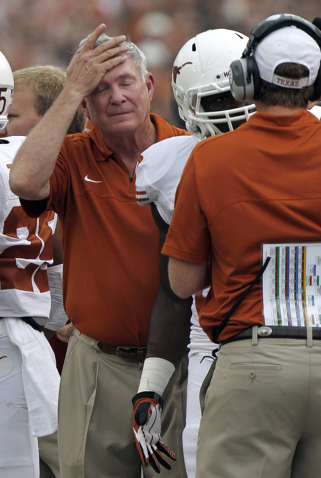Photo -   Texas head coach Mack Brown reacts after an interception during the first half of an NCAA college football game against Oklahoma at the Cotton Bowl Saturday, Oct. 13, 2012, in Dallas. (AP Photo/LM Otero)