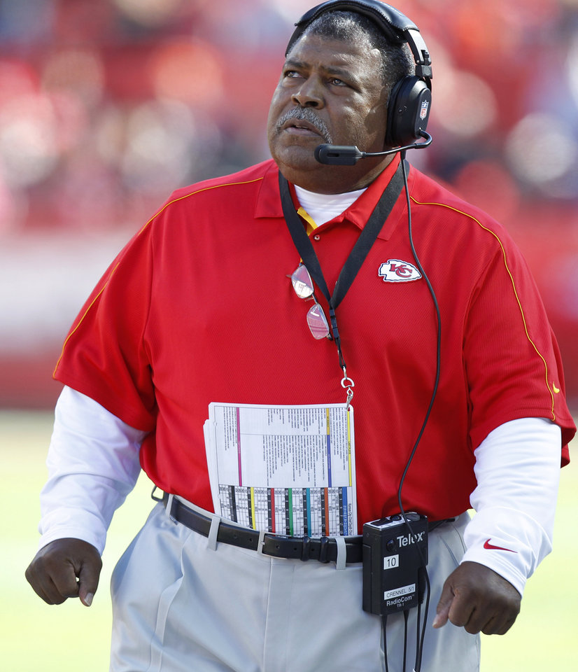 Kansas City Chiefs coach Romeo Crennel looks at the clock during the first half of an NFL football game against the Denver Broncos at Arrowhead Stadium in Kansas City, Mo., Sunday, Nov. 25, 2012. (AP Photo/Ed Zurga)