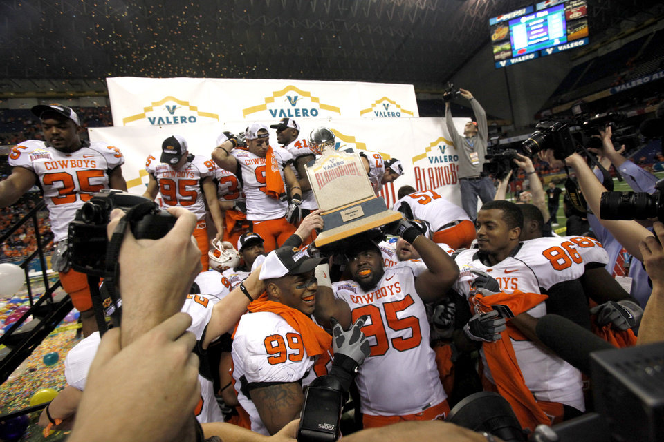 Photo - Oklahoma State's  Chris Donaldson celebrates the team's win over Arizona in the Valero Alamo Bowl  at the Alamodome in San Antonio, Texas, Wednesday, December 29, 2010. OSU won, 36-10. Photo by Sarah Phipps, The Oklahoman