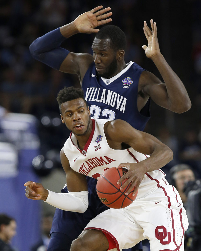 Photo - Villanova's Daniel Ochefu (23) defends Oklahoma's Buddy Hield (24) during the national semifinal between the Oklahoma Sooners (OU) and the Villanova Wildcats in the Final Four of the NCAA Men's Basketball Championship at NRG Stadium in Houston, Saturday, April 2, 2016. Photo by Nate Billings, The Oklahoman