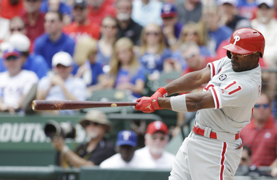 Philadelphia Phillies\' Jimmy Rollins hits a grand slam home run against the Texas Rangers during the second inning of an opening day baseball game at Globe Life Park, Monday, March 31, 2014, in Arlington, Texas. (AP Photo/Kim Johnson Flodin)