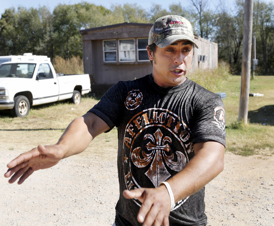 Photo -  Johnathan Chouinard recounts the events of Sunday night when he and his wife, Jamie, were pulling into the driveway at Bear Creek mobile home community and had their car stolen. [Photo by Jim Beckel, The Oklahoman]