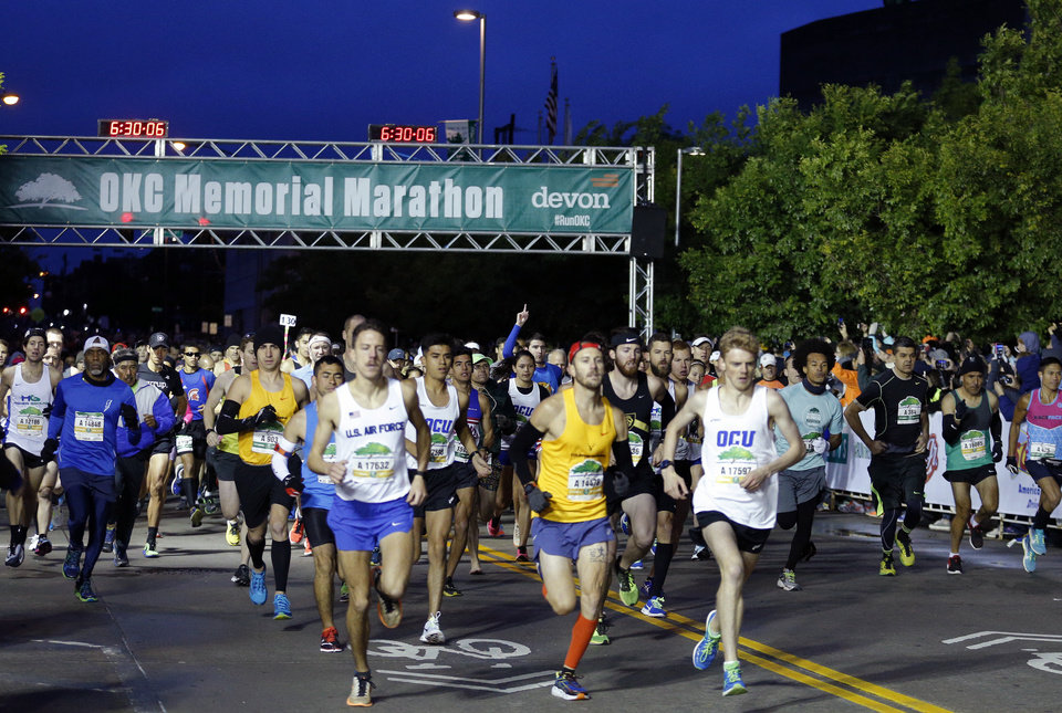 Photo - Runners start the race during the 2017 Oklahoma City Memorial Marathon Sunday, April 30, 2017.  Photo by Sarah Phipps, The Oklahoman