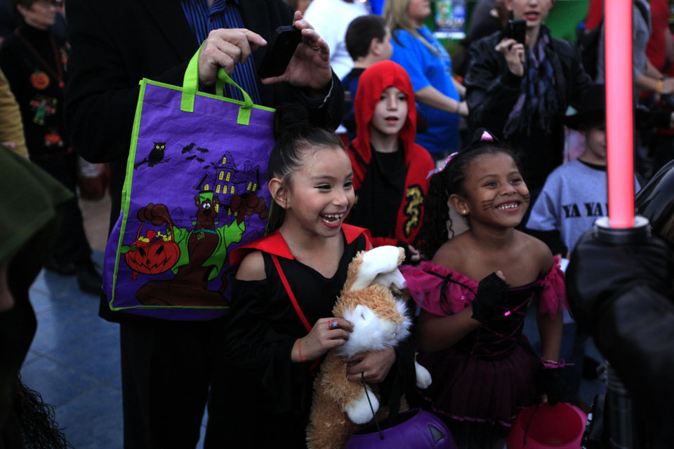 HALLOWEEN-RELATED ACTIVITIES / CHILD / CHILDREN / KIDS: Bianca Ortiz, left, and Alexandria Espinoza laugh during Haunt the Zoo at the Oklahoma City Zoo in  Oklahoma City, Tuesday, Oct. 30, 2012. Photo by Sarah Phipps, The Oklahoman