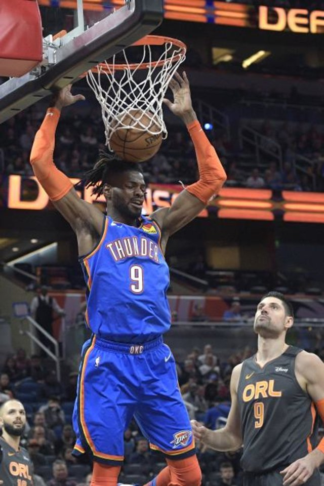 Photo -  Oklahoma City Thunder center Nerlens Noel (9) dunks the ball in front of Orlando Magic center Nikola Vucevic (9) and guard Evan Fournier, left, during the first half of an NBA basketball game Wednesday, Jan. 22, 2020, in Orlando, Fla. (AP Photo/Phelan M. Ebenhack)
