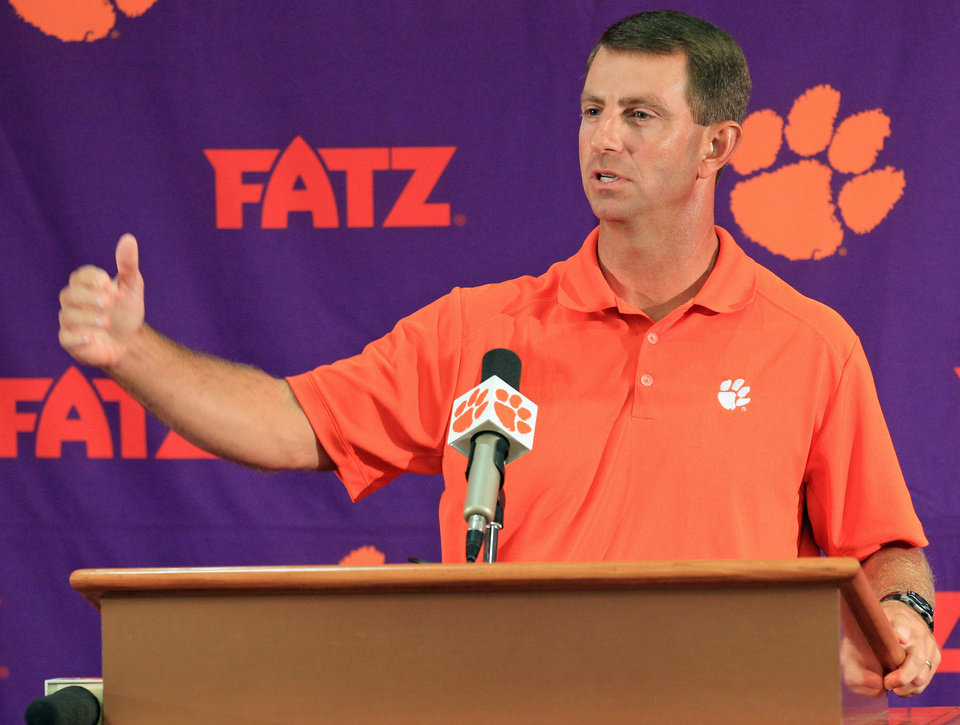 Photo - Clemson head coach Dabo Swinney discusses the Tigers' NCAA college football 2014 season at Memorial Stadium in Clemson, S.C. on Tuesday, Aug. 26, 2014. Clemson opens the season at Georgia on Aug. 30. (AP Photo/Anderson Independent-Mail, Mark Crammer) GREENVILLE NEWS OUT, SENECA NEWS OUT