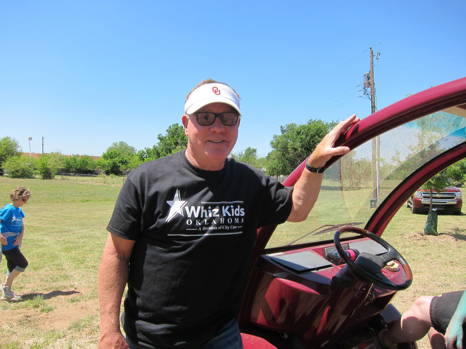 "Photo -  Larry Bross, executive director of City Care ministries, prepares to drive volunteers to different parts of Crystal Lake during the recent Whiz Kids ""Spring Fling"" celebration at the Oklahoma City lake. Photo by Carla Hinton, The Oklahoman"