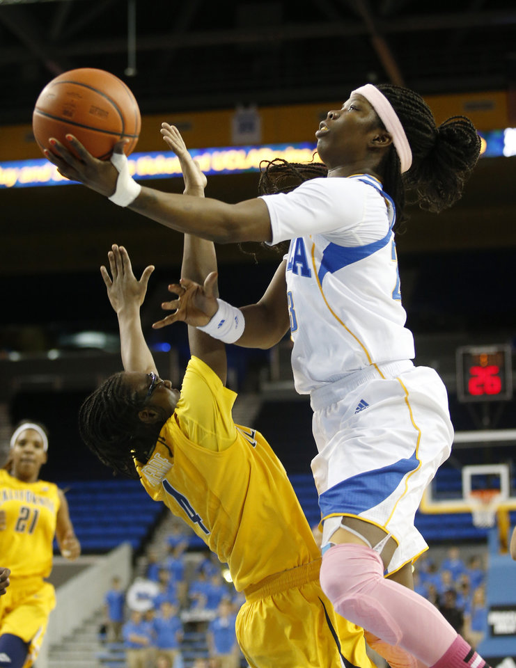UCLA guard Markel Walker, right, shoots over California guard Eliza Pierre during the second half of an NCAA women\'s basketball game in Los Angeles, Friday, Feb. 15, 2013. California won 79-51. (AP Photo/Jae C. Hong)