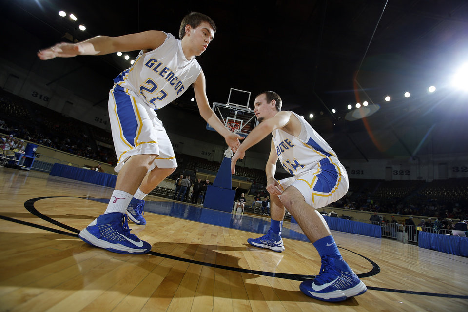 Glencoe's Jake Lazenby, left, and Tyalor Cavett cheer during introductions during the Class A boys semifinal game of the state high school basketball tournament between Glencoe and Sterling at the State Fair Arena., Friday, March 1, 2013. Photo by Sarah Phipps, The Oklahoman