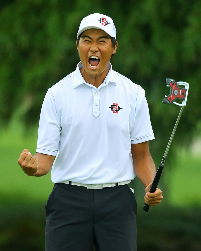 Photo - Gunn Yang, of San Diego, Calif., reacts to sinking his par putt on the 17th hole during the afternoon round to win the 36-hole championship match of the 2014 U.S. Amateur Championship at Atlanta Athletic Club on Sunday, Aug.17, 2014, in Johns Creek, Ga.  (AP Photo/Atlanta Journal-Constitution, Curtis Compton)  MARIETTA DAILY OUT; GWINNETT DAILY POST OUT; LOCAL TELEVISION OUT; WXIA-TV OUT; WGCL-TV OUT