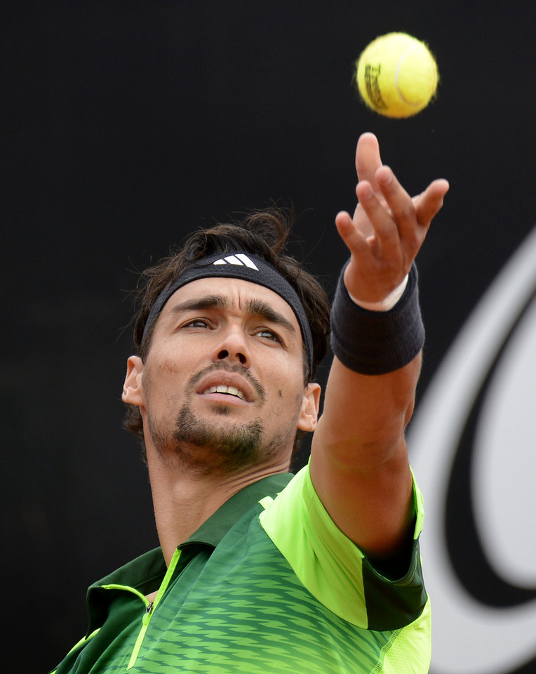 Photo - Italy's Fabio Fognini  serves a ball to Roberto Bautista Agut, from Spain,  during their semifinal match of the  Mercedes Cup ATP  tennis tournament in Stuttgart, Germany, Saturday July 12, 2014.   (AP Photo/dpaDaniel Maurer)