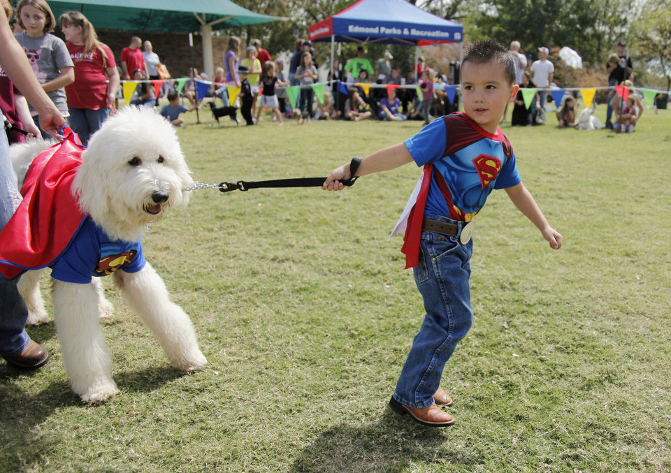Mason Williams, 4, and his Labradoodle Bear are dressed as Superman for the Look Alike category during the Krazy Kids Dog Show at Shannon Miller Park in Edmond Saturday, September 24, 2011. Photo by Doug Hoke, The Oklahoman.