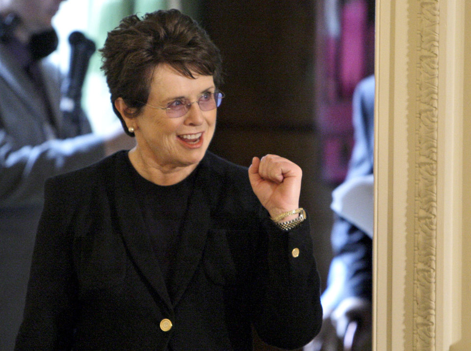 Photo - FILE - In this Aug. 12, 2009 file photo, tennis great Billie Jean King reacts as she enters the East Room of the White House in Washington, for a ceremony where President Barack Obama awarded her a 2009 Presidential Medal of Freedom. King believes standing up to discrimination is the best way to combat it. She will help lead the U.S. delegation in the opening ceremonies at the Sochi Olympics in Russia, which recently passed an anti-gay law. (AP Photo/Alex Brandon, File)