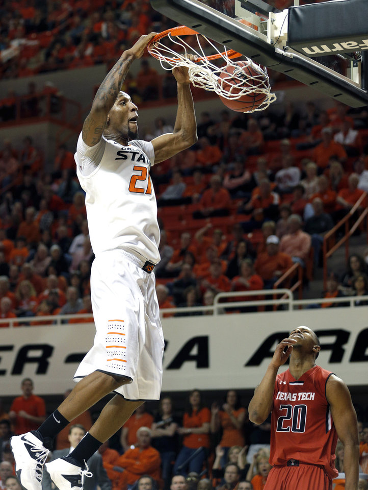 Photo - Oklahoma State's Kamari Murphy (21) dunks in front of Toddrick Gotcher (20) during the men's college basketball game between Oklahoma State and Texas Tech at Gallagher-Iba Arena in Stillwater, Okla., Saturday, Feb. 22, 2014. OSU won 84-62. Photo by Sarah Phipps, The Oklahoman