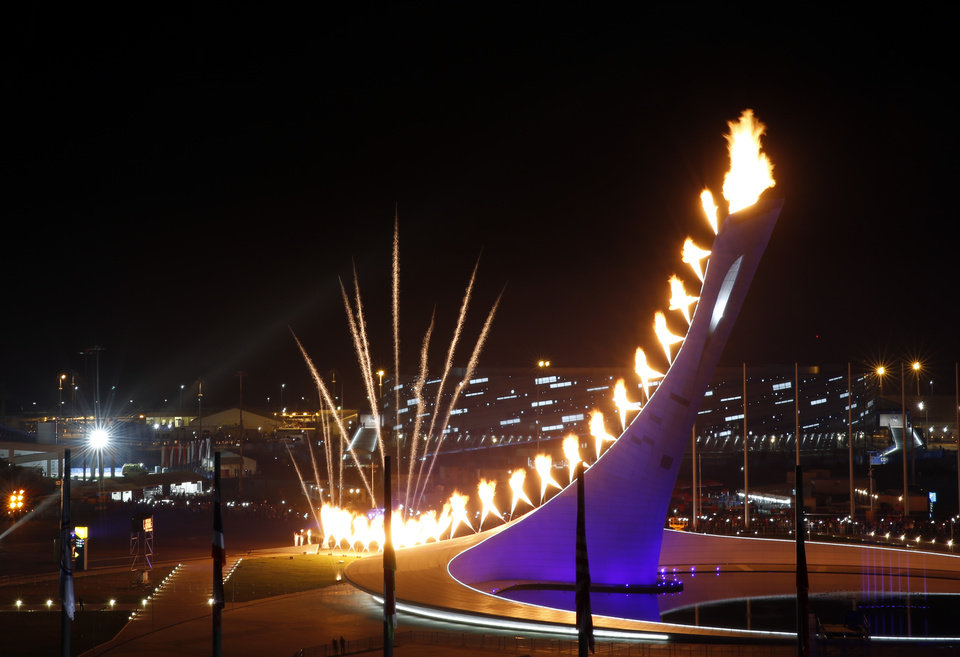 Photo - The Olympic Cauldron is lit during the opening ceremony of the 2014 Winter Olympics in Sochi, Russia, Friday, Feb. 7, 2014. (AP Photo/Julio Cortez)