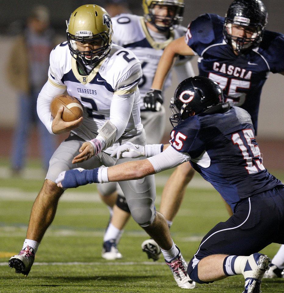 Photo - Heritage Hall's Quinn Shanbour tries to get past Cascia Hall's Bryce Carter during the Class 3A high school football semifinal game between Heritage Hall and Cascia Hall at Pioneer Stadium in Stillwater, Okla., Friday, Dec. 2, 2011. Photo by Bryan Terry, The Oklahoman
