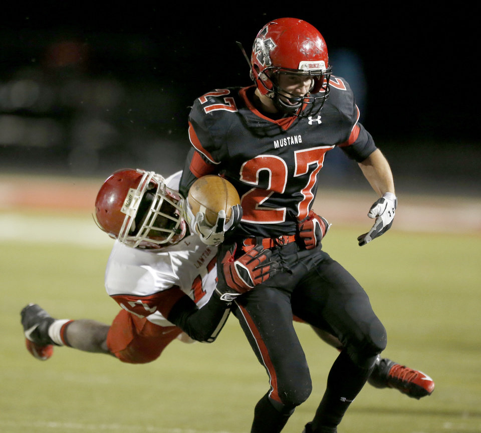 Lawton\'s Kalin Sadler tackles Mustang\'s Kale Harper during the high school football game between Mustang and Lawton at Mustang High School in Mustang, Okla., Friday, Oct. 26, 2012. Photo by Sarah Phipps, The Oklahoman