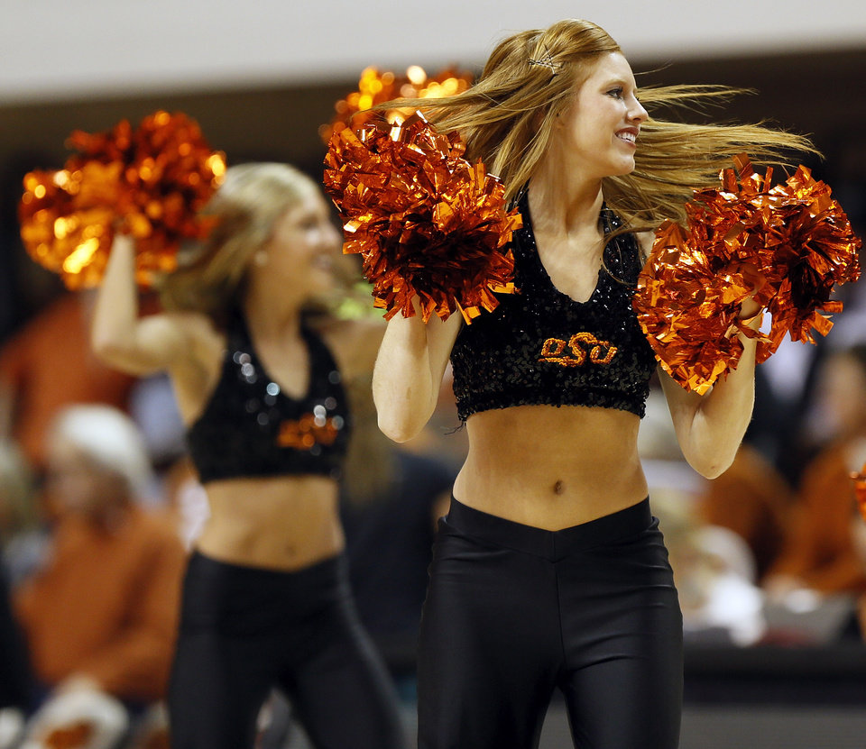 Photo - Members of the OSU pom squad dance during a women's college basketball game between Oklahoma State University (OSU) and the University of Texas at Gallagher-Iba Arena in Stillwater, Okla., Saturday, March 2, 2013. OSU won, 64-58. Photo by Nate Billings, The Oklahoman