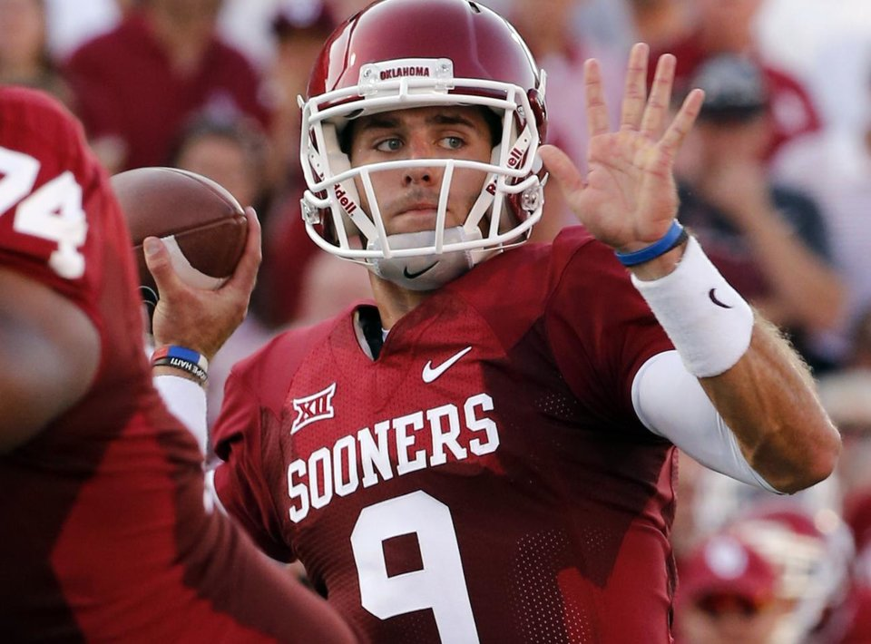 Photo - Sooner Treavor Knight passes during a college football game between the University of Oklahoma Sooners (OU) and the Louisiana Tech Bulldogs at Gaylord Family-Oklahoma Memorial Stadium in Norman, Okla., on Saturday, Aug. 30, 2014. Photo by Steve Sisney, The Oklahoman