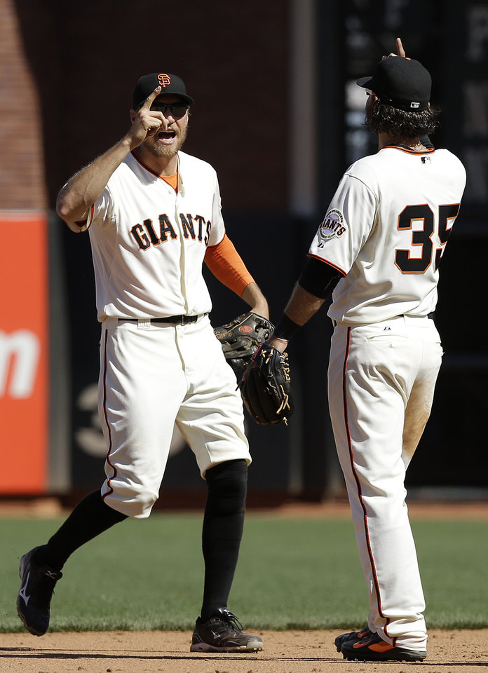 Photo - San Francisco Giants right fielder Hunter Pence, left, and shortstop Brandon Crawford (35) celebrate after the Giants defeated the Atlanta Braves 10-4 in a baseball game in San Francisco, Wednesday, May 14, 2014. (AP Photo)