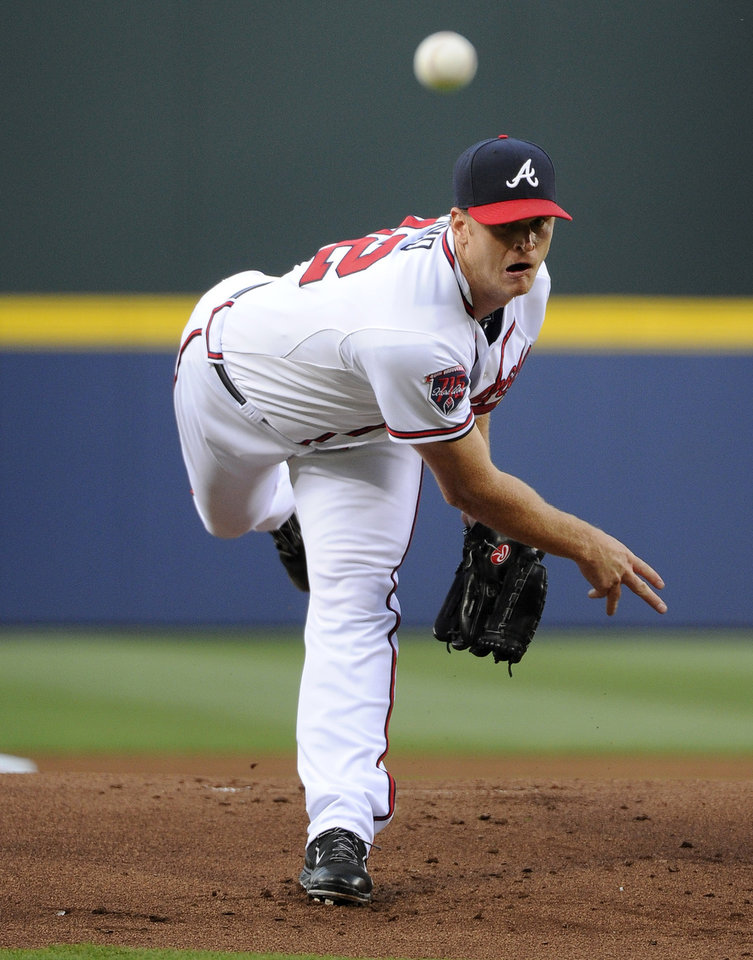 Photo - Atlanta Braves starting pitcher Gavin Floyd delivers to the Colorado Rockies during the first inning of a baseball game Friday, May 23, 2014, in Atlanta. (AP Photo/David Tulis)