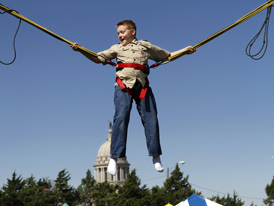 Photo - Steinbron, of Edmond, plays on a bungee jump trampoline at Septemberfest in 2012. PHOTO BY JIM BECKEL, THE OKLAHOMAN ARCHIVE  Jim Beckel