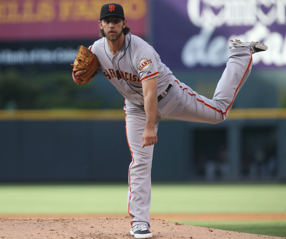 Photo - San Francisco Giants starting pitcher Madison Bumgarner works agaisnt the Colorado Rockies in the first inning of a baseball game in Denver on Tuesday, May 20, 2014. (AP Photo/David Zalubowski)