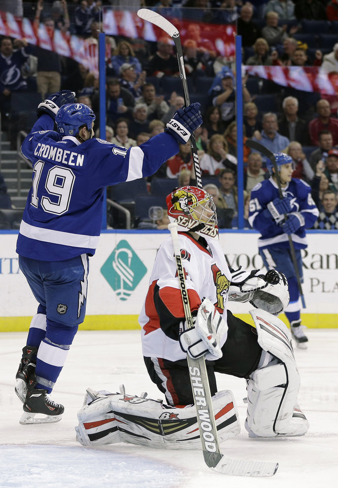 Photo - Tampa Bay Lightning right wing B.J. Crombeen (19) celebrates after scoring past Ottawa Senators goalie Craig Anderson (41) during the second period of an NHL hockey game Thursday, Jan. 23, 2014, in Tampa, Fla. (AP Photo/Chris O'Meara)