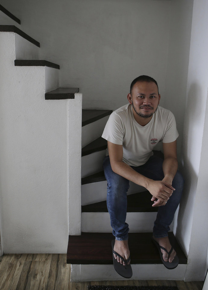 "In this May 8, 2013 photo, Filipino director Borinaga Alix Jr. poses inside his home in suburban Quezon city, north of Manila, Philippines. Alix chose to film ""Death March"" in black-and-white and almost entirely inside a studio using hand-painted backdrops, with close-ups of actors' painted faces portraying their struggles with nightmares and hallucinations in one of the bloodiest episodes of World War II. (AP Photo/Aaron Favila)"