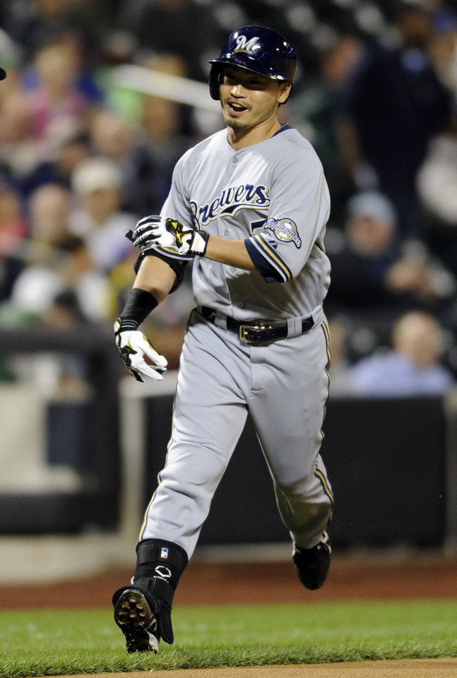 Photo - Milwaukee Brewers' Norichika Aoki reacts as he rounds the bases with a home run during the first inning of a baseball game against the New York Mets Friday, Sept. 27, 2013, in New York. (AP Photo/Bill Kostroun)