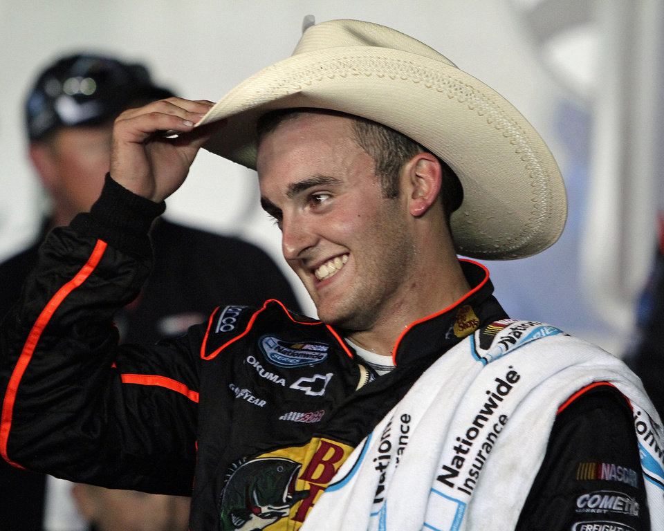 Photo -   Austin Dillon tips his cowboy hat after winning the NASCAR Nationwide Series auto race at Kentucky Speedway in Sparta, Ky., Friday, June 29, 2012. (AP Photo/Garry Jones)