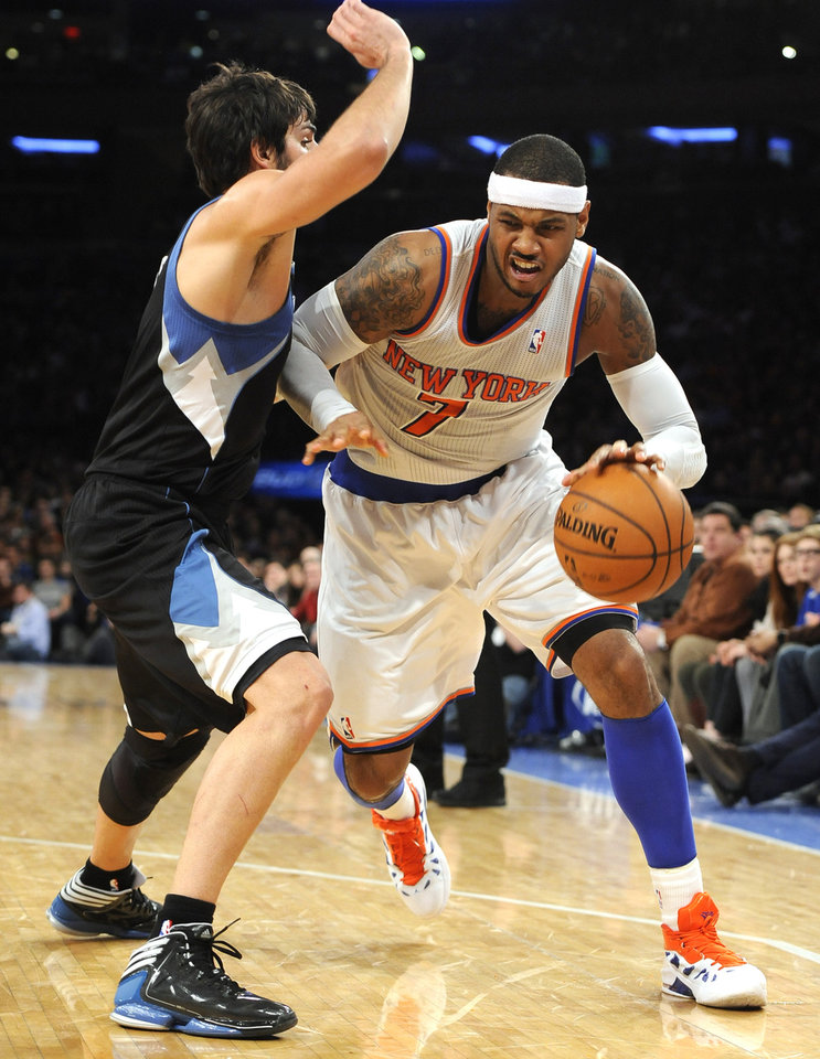 New York Knicks' Carmelo Anthony (7) drives the ball around Minnesota Timberwolves' Ricky Rubio (9) in the first half of an NBA basketball game on Sunday, Dec., 23, 2012, at Madison Square Garden in New York. The Knicks won 94-91. (AP Photo/Kathy Kmonicek)