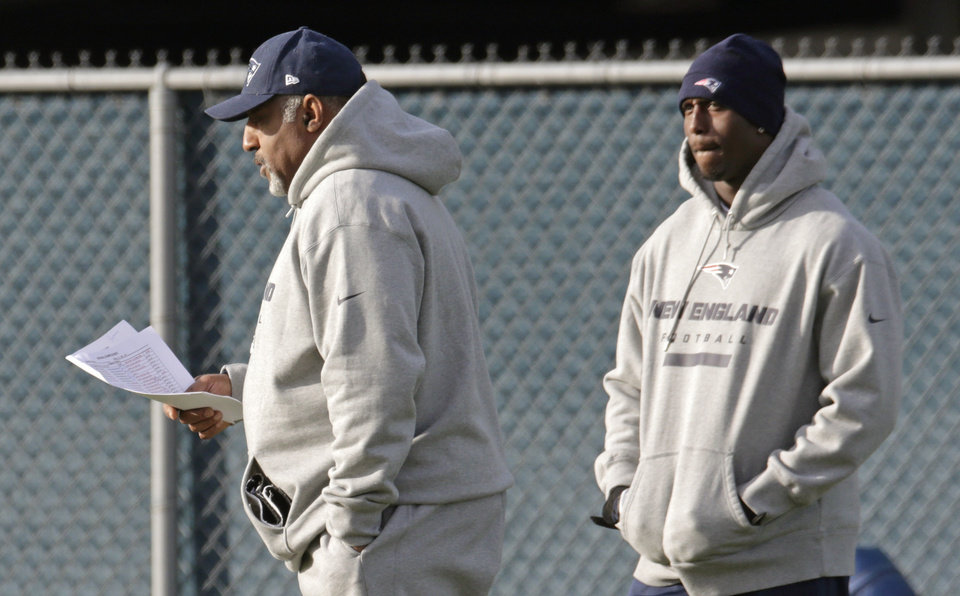 New England Patriots cornerback Devin McCourty, right, watches as running back coach Ivan Fears checks his notes prior to a football practice in Foxborough, Mass., Tuesday, Nov. 20, 2012. (AP Photo/Charles Krupa)