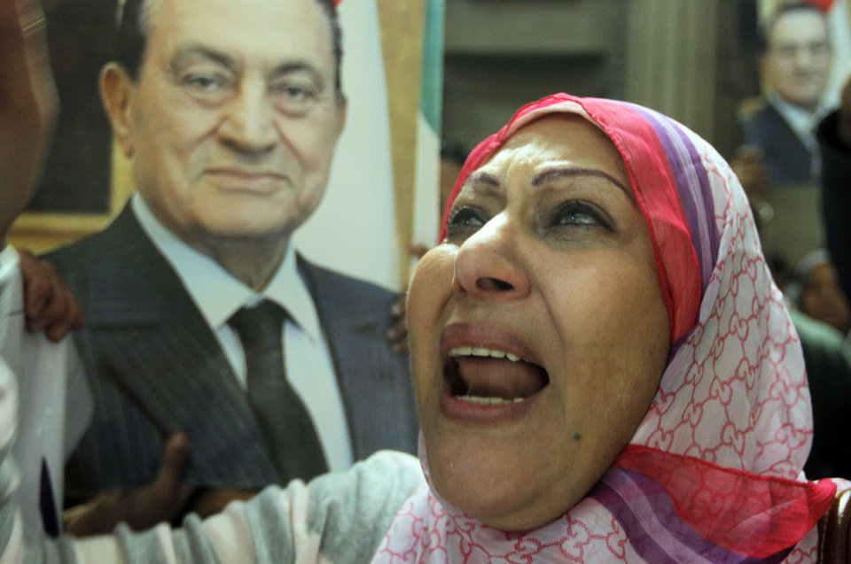 An Egyptian supporter of ousted former President Hosni Mubarak celebrates an appeal granted by a court, in Cairo, Egypt, Sunday, Jan. 13, 2013. A court granted Hosni Mubarak's appeal of his life sentence in a Sunday, Jan. 13, 2013 hearing, ordering a retrial of the ousted Egyptian president on charges that he failed to prevent the killing of hundreds of protesters during the uprising that toppled his regime nearly two years ago. The ruling came one day after a prosecutor placed a new detention order on Mubarak over gifts worth millions of Egyptian pounds (hundreds of thousands of US dollars) he and other regime officials allegedly received from Egypt's top newspaper as a show of loyalty while he was in power. (AP Photo/Amr Nabil)