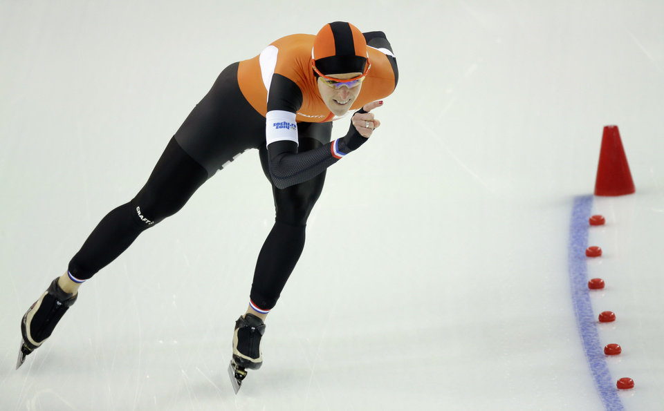 Photo - Ireen Wust of the Netherlands competes in the women's 1,500-meter race at the Adler Arena Skating Center during the 2014 Winter Olympics in Sochi, Russia, Sunday, Feb. 16, 2014. (AP Photo/David J. Phillip )