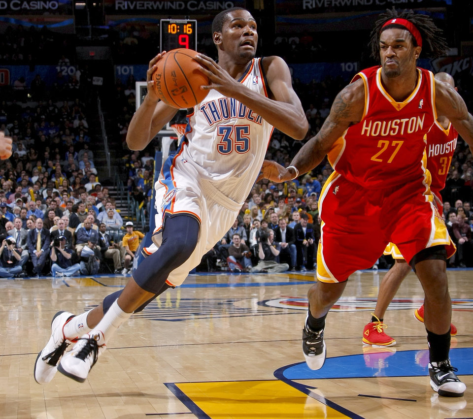 Photo - Oklahoma City's Kevin Durant drives past Houston's Jordan Hill during the NBA basketball game between the Oklahoma City Thunder and the Houston Rockets at the Oklahoma City Arena on Wednesday, December 15,  2010.   Photo by Bryan Terry, The Oklahoman